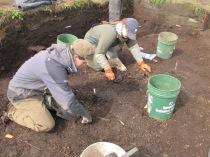 Ellen & Jacqui excavating house floor
