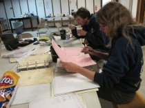 sorting out the paper records